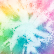 Rainbow Tie Dye Star Burst Pattern Background.