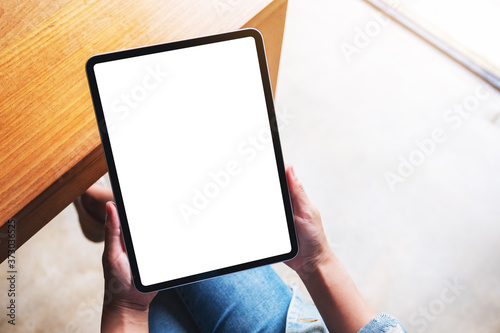 Top view mockup image of a woman holding digital tablet with blank white desktop Fototapeta