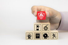 Close-up Hand Choose Fire Prevent Icon On Cube Wooden Toy Blocks Stacked With Fire Prevention Icon For Safety Emergency Concepts.