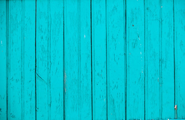 Vintage blue wood background texture with knots and nail holes. Old painted wood wall. Blue abstract background. Vintage wooden dark horizontal boards. Front view with copy space