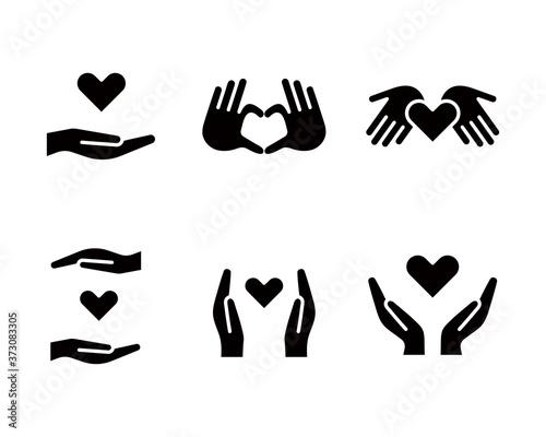 手とハートのアイコンのセット/チャリティー/優しさ/愛/医療/支え/援助 Fototapet