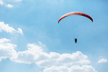 Red Paraglider Flying Into The...