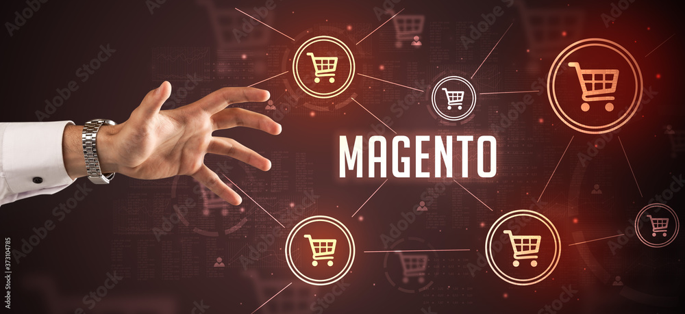 Fototapeta Close-Up of cropped hand pointing at MAGENTO inscription, online shopping concept