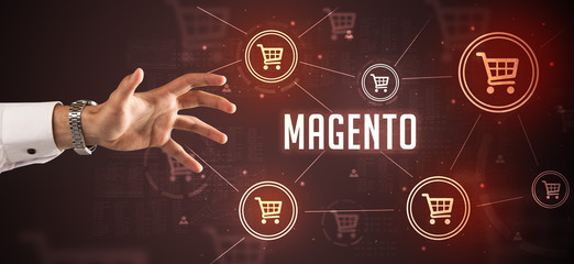 Close-Up of cropped hand pointing at MAGENTO inscription, online shopping concept