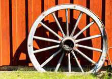 View Of An Old Wagon Wheel Against The Sunlight