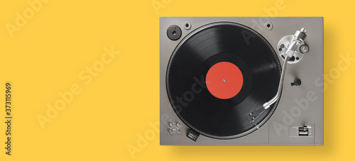 Photo turntable with lp vinyl record. Above view
