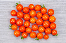 Bird's Eye View Of Freshly Picked Cherry Tomatoes On A Grey PVC Deck Board