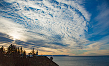 The Cape Disappointment Lighthouse At The Mouth Of The Columbia River With A Large Buttermilk Cloud Sky, Near Ilwaco On The Washington Coast