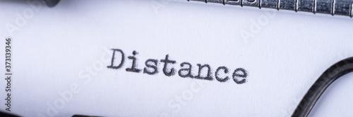 Distance on white sheet in vintage typewriter. Panoramic image Canvas Print