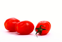 Baby Plum Tomatoes Isolated On A White Background