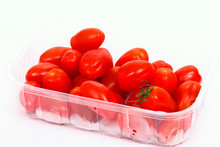 Baby Plum Tomatoes In A Plastic Punnet Isolated On A White Background