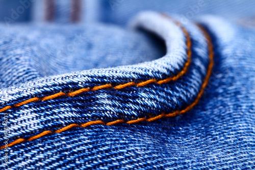 Photo Background of blue indigo denim jeans and stiching