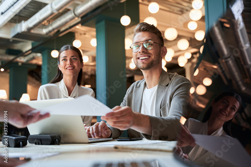Two ambitious young people feeling happy about their career Canvas Print