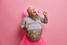 Overjoyed Bearded Plump Man We...