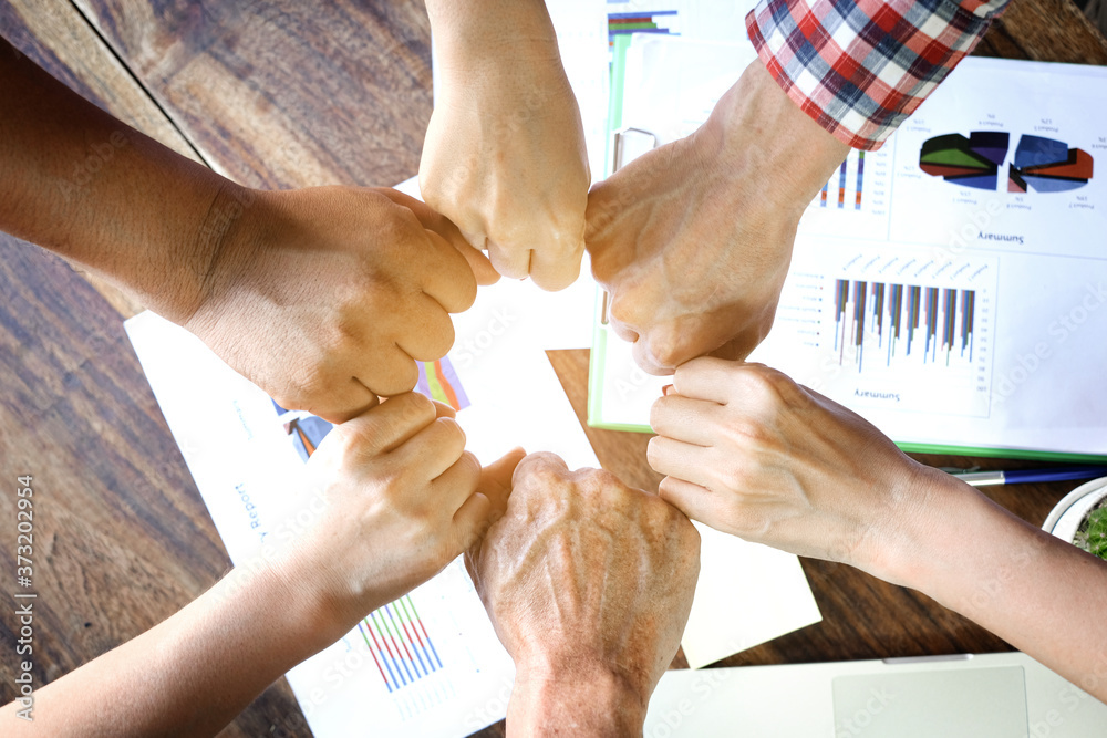 Fototapeta Four hand up of people working assemble corporate meeting show symbol Join forces teamwork quality and effective personnel