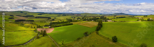 Fotografie, Obraz Aerial shot of beautiful views of Southdean hamlet in Scotland