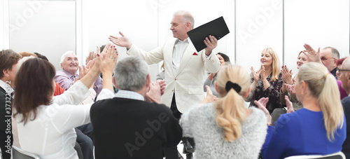 Obraz na plátně Rear view aged businessman receiving report with partners at con