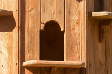 Close Up Of Wooden Dovecote Entrance On Summer Day