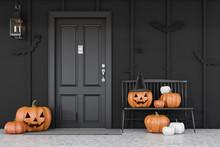 Black House Door With Carved Pumpkins
