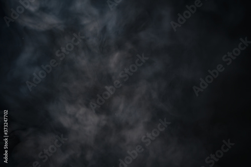 Stampa su Tela Closeup shot of rising smoke against a black background