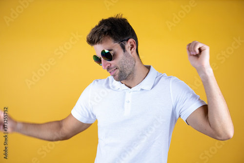 Fototapeta Hangover man drunk and crazy for hangover wearing sunglasses celebrating mad and crazy for success