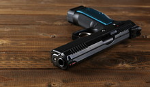 Pistol 9 Mm, New Handgun Semi-automatic On Wooden Planks, Boards, Table Background