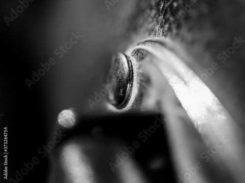 Fototapeta Close up of a metal stud