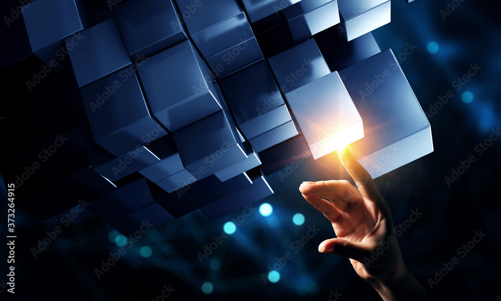 Fototapeta Hand holding glowing cubes. Innovation and creativity concept.