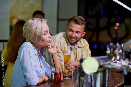 the guy liked the girl at the bar, came to become acquainted, talk, look at her Canvas Print