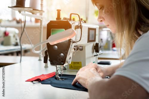 Fotografia, Obraz Designer tailor sew the dress