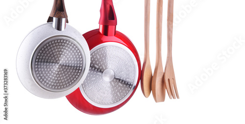 Canvastavla Two hanging frying pans and kitchen utensils