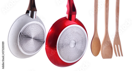 Two hanging frying pans and kitchen utensils Fototapet