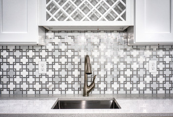 Interior of a modern kitchen with a golden faucet
