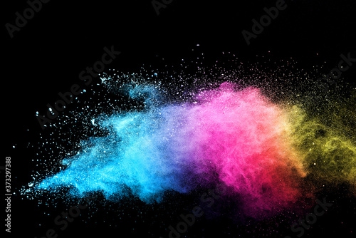 Cuadros en Lienzo Explosion of colored powder isolated on black background.