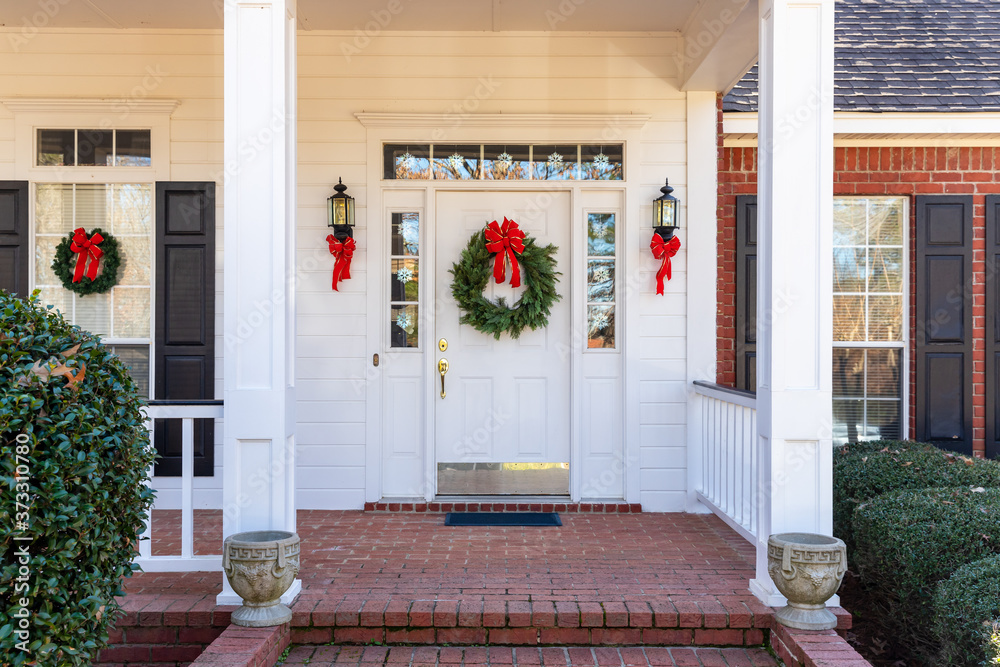 Fototapeta Residential home front door decorated for Christmas