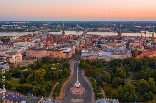 Fotografija Freedom Square surrounded by buildings and greenery during the sunset in Riga, L