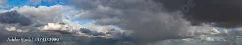 Fotografie, Obraz Fantastic dark thunderclouds, sky panorama