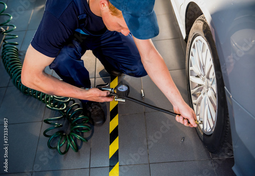 Professional car mechanic working with in auto repair service Fotobehang