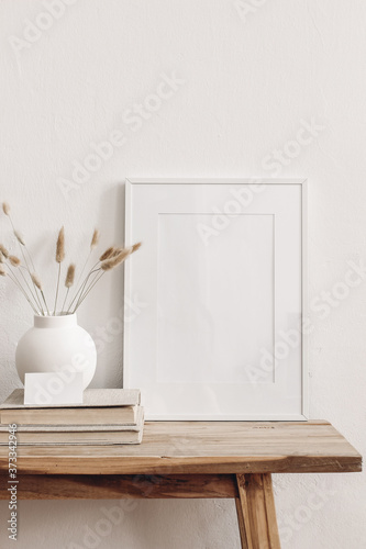 Foto Portrait white picture frame mockup on vintage bench, table