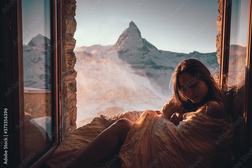 Fototapeta Woman tourist selfie near the Matterhorn mountain.Famous popular touristic place in the world.