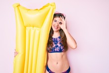 Beautiful Young Caucasian Woman Wearing Bikini And Holding Summer Matress Float Smiling Happy Doing Ok Sign With Hand On Eye Looking Through Fingers