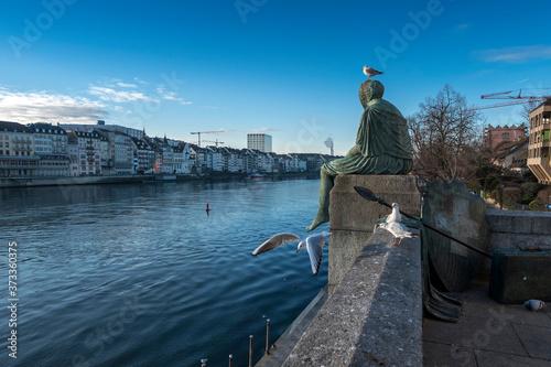 Fototapeta Helvetia sits on the stone railing of the bridge