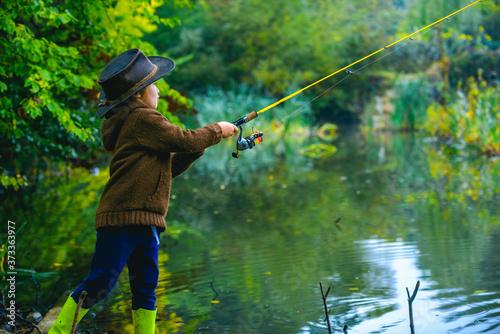 Obraz na plátně Little boy child catching a fish