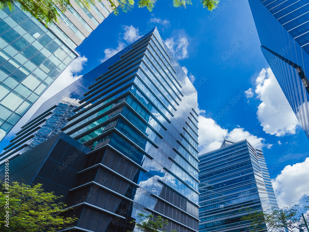 Fototapeta Glassy highrises along 5th avenue, Bonifacio Global City in Philippines. A modern central business district.