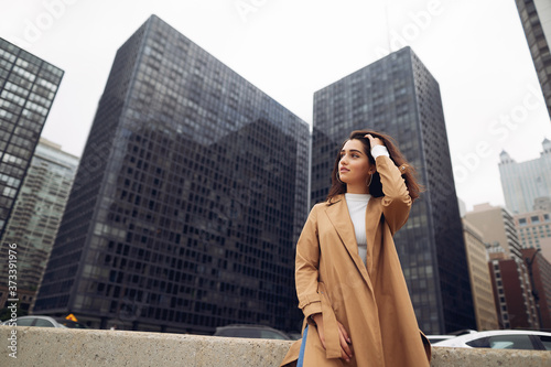 woman walks the streets of Chicago in a brown cloak Canvas Print