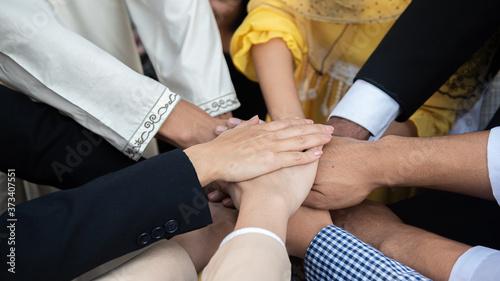 Obraz na plátne Teamwork diversity business people join hand together for successful goal setting