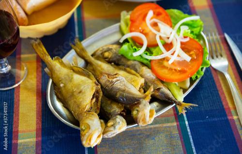 Fotografija Appetizing fried fish scad. Spanish dish. High quality photo