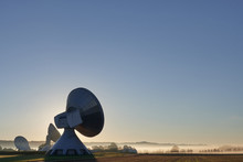 Sunrise On Raisting Erdfunkstelle Telecommunication Site And Its Dish Antennas For Satellite Communication, Landscape Wide-angle Shot With Copy Space