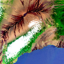 The Mauna Loa Volcano In Hawaii From Space In Satellite Image. Largest Volcano In The World, Magma Runoff, Clouds, Vegetation And The Sea Are Observed. Contains Modified Sentinel Sensor Data.