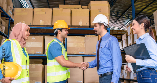 Fotografie, Obraz Group of Diversity warehouse worker hand shaking when success the agreement toge